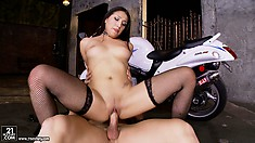 Slutty brunette babe in black fishnets rides his cock like a cowgirl