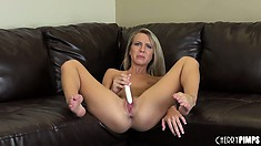 She sticks her ass out as she fingers then sits and toys her cunt