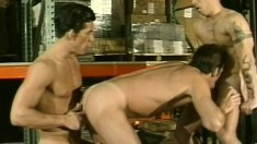 Muscled warehouse workers ravage a dude in both of his holes